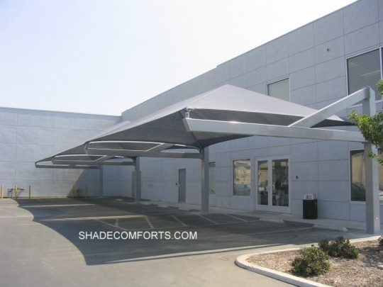 This cantilevered car shelter cools vehicles in the parking lot at a Visalia auto dealer. We were the supplier and contractor of this car shelter. & Parking Shade Canopy - Covered Parking Structures -California Carports